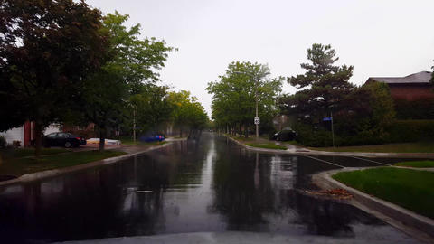 Driving Residential Suburb in the Rain During Day. Driver... Stock Video Footage
