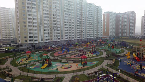 A large and colorful playground in a residential area Footage