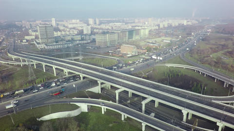 An aerial view of a road interchange against the misty urban view Footage