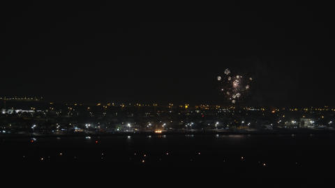 A night urban view with bright firework over it Footage