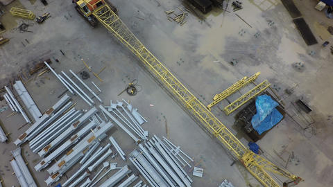 An aerial view of a construction crane lying on the ground Footage