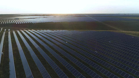 Aerial desert view large industrial Solar Energy Farm producing concentrated Live Action
