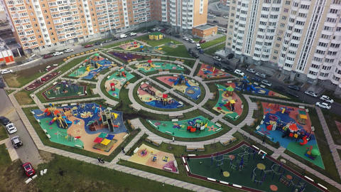 An aerial view of a large playground area in a residential microdistrict Footage