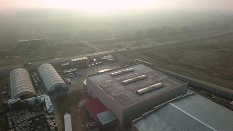 An aerial view of warehouses near the suburban road Footage