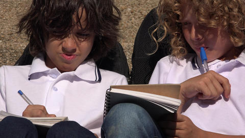 Young Students Thinking And Writing Live Action