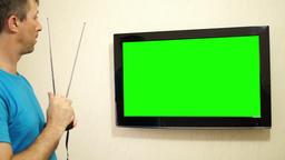 Flatscreen TV Adjusting Antenna Green Screen Live Action