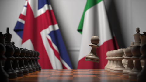 Chess game against flags of Great Britain and Italy. Political competition Live Action
