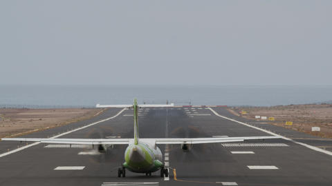 Aircraft taking off from runway by the ocean Footage