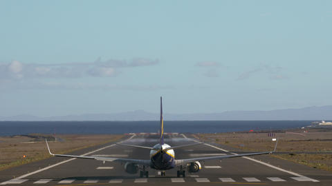 Aircraft take-off. Runway with view to sea and mountains Footage