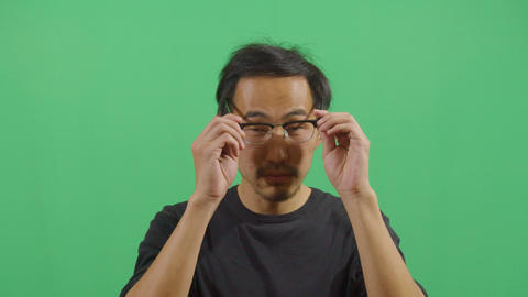 Adult Man Putting On Prescription Glasses Live Action