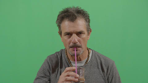 Adult Man Drinking Water With A Plastic Straw Live Action