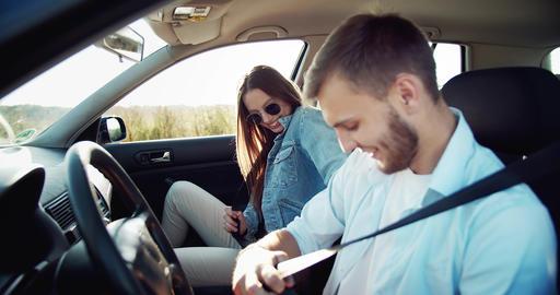 Couple Fastening Seat Belts Footage