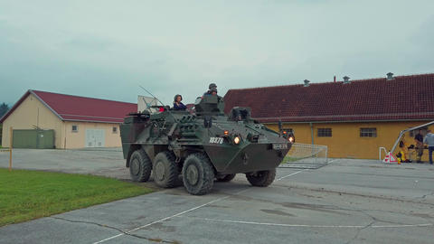 Children ride a modern combat vehicle, armored personnel… Stock Video Footage