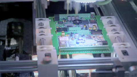 Electronic circuit board production. Automated Circut Board machine Produces Footage