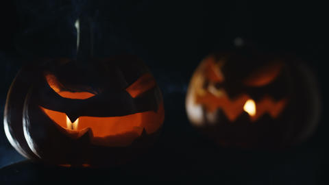 Pumpkins Jack o lantern face with lights and smoke for Halloween night Live Action