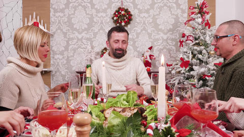 Caucasian big family celebrating christmas together with delicious food Footage