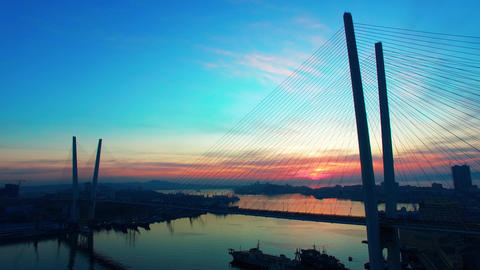 Aerial view of Golden horn Bay and Golden bridge at sunset. Vladivostok, Russia Live Action