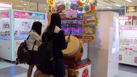 Asian Girls Playing Video Game In Arcade Of Yamagata Japan Footage