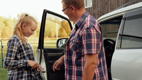 Father giving car keys to daughter teenager for riding. Girl teenager receiving Footage