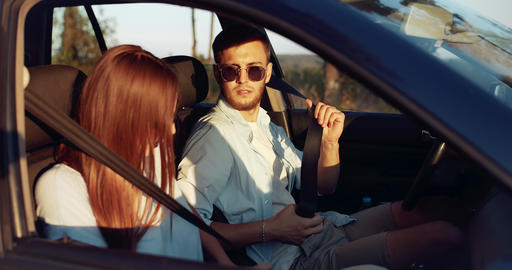 Happy Couple Fastening Seat Belts Sunset Footage