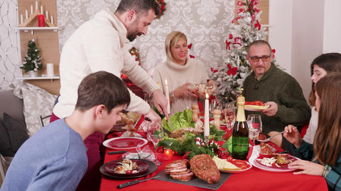 Cheerful big family enjoying traditional tasty food Footage