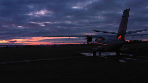 A small motor plane is at the airport at sunset 001 Stock Video Footage