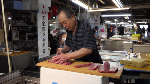 Japanese Man Cutting Fresh Tuna Slices For Sushi At Market, Live Action