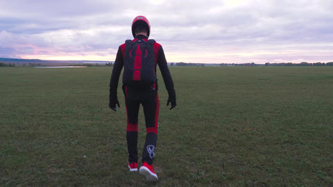 Skydiver in uniform is an empty field 001 Live Action