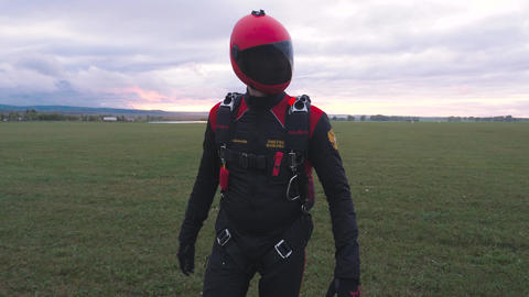 Skydiver in uniform is an empty field 002 Live Action