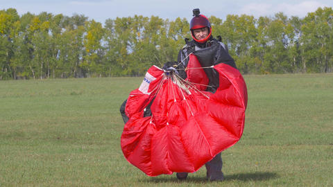 Skydiver parachute collapses after landing 002 Live Action