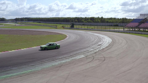 Aerial view sport car racing on speed drift track. Rear wheel drive jdm car drifting on turn on Live Action