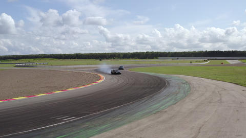 Drone view sport cars drifting on track while speed competition. Two japanese jdm car driving on Footage