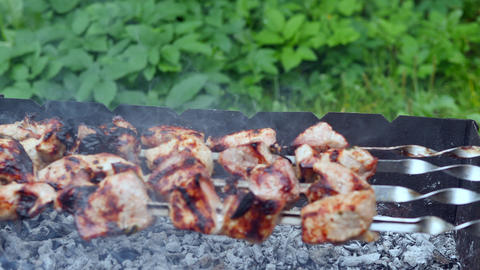 Grilling meat bbq on smoking charcoal outdoor. Close up meat barbecue on charcoal grill. Cooking Live Action