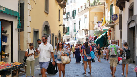 People crowd on the street in Amalfi - Medium shot Live Action