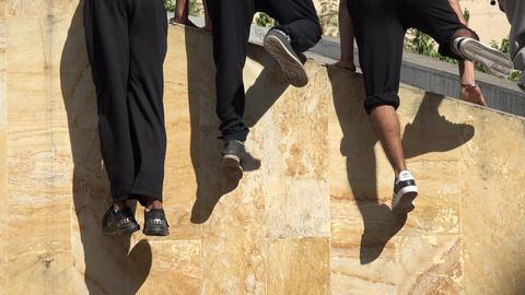 Teenagers Climbing A Wall Footage