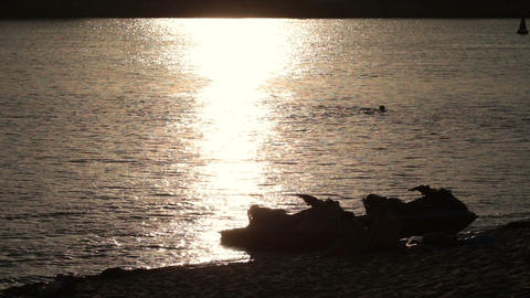 Silhouette jet ski on seashore in yellow sunset Footage