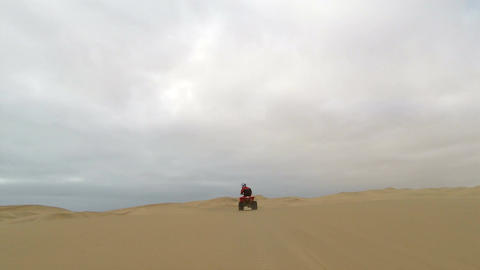 Quad biking through the sand dunes of Namib Desert, Namibia Footage