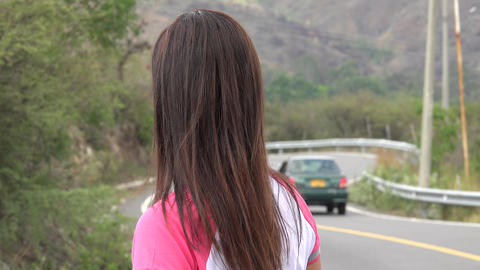 Woman Standing At Curved Mountain Road Live Action