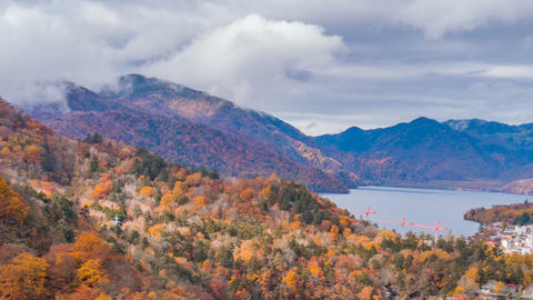 Colorful mountain landscape and lake with sunlight in autumn season, time lapse Live Action