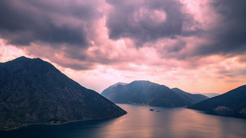 The movement of rain clouds over the mountains in Montenegro at sunset Footage