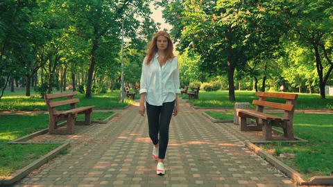girl walks outdoors summer season daytime Footage