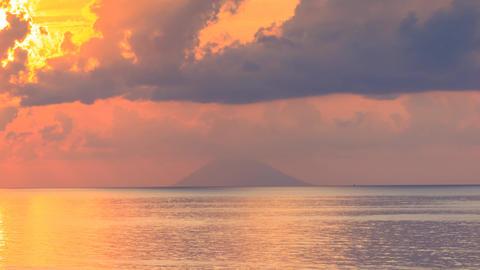Stromboli volcano on sea horizon timelapse Live Action