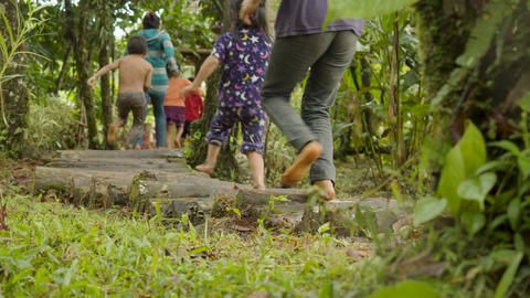 Indigenous People Are Running Barefoot On A Forest Path Live Action