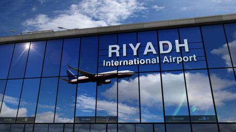 Airplane landing at Riyadh mirrored in terminal Live Action