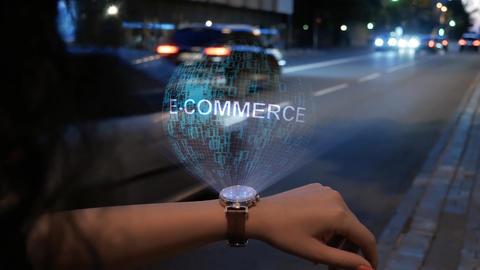 Unrecognizable woman with hologram E-commerce Live Action