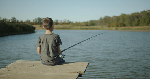 A little boy holding a fishing rod. fishing concept Live Action