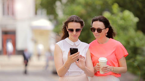 Lifestyle selfie portrait of two young positive woman having fun and making Live Action