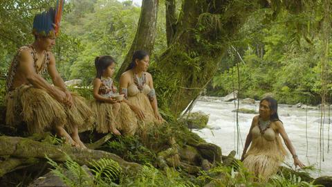Indigenous Family Walking Through The Amazon Rainforest Live Action