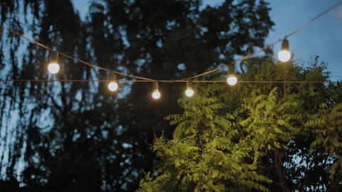 Electric garland with bulbs in the evening Footage