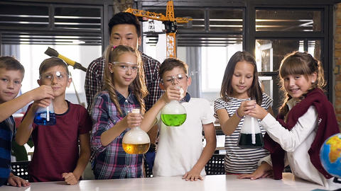 Portrait shot of Korean science man teaching young students doing chemical Footage